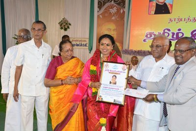 Sudha received the title of 'Mutthamizh Perarignar' from the Madurai Tamizh Isai Sangam