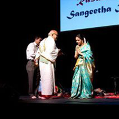 Sudha received the Rasikas New Zealand Lifetime Achievement Award from Sri. Aravamudhan Gopalan Iyengar at the Raye Freedman Arts Centre, Epsom, Auckland, New Zealand