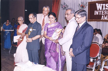 Receiving the 'Honorary' Award from Shri N. Murali, on behalf of the Rotary Club of Madras North